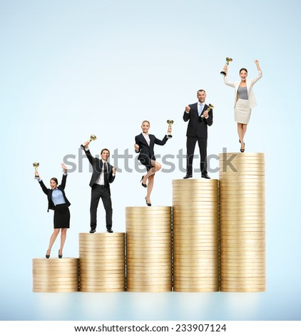 Business team with cups standing on the stairs of gold coins. Concept of business success - stock photo