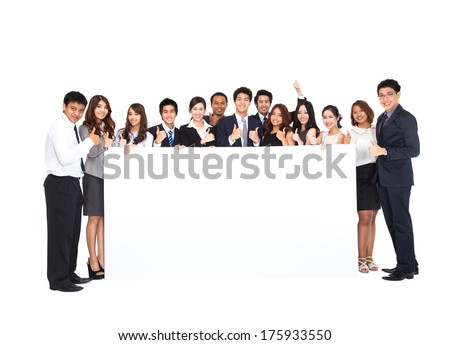 Business Team with empty banner - stock photo