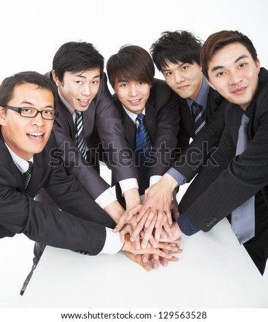 business team with hand together on the table - stock photo