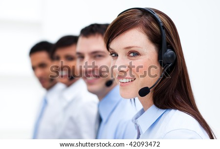 Business team with headset on working in a call center and smiling at the camera