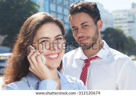 Business team with phone in the city - stock photo