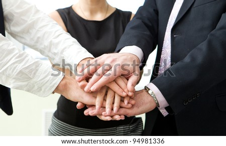 business team with their hands together