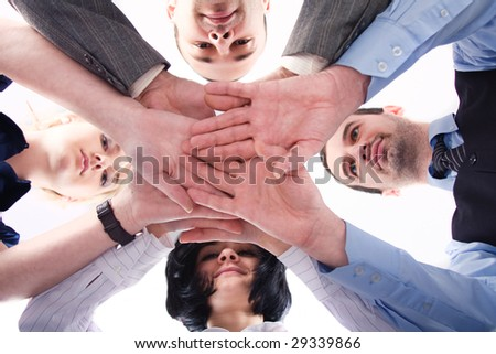 Business team with their hands together over white - stock photo