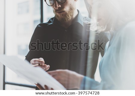 Business team work process modern office.Photo professional crew working with new startup project. Project managers meeting. Analyze  plans.Coworking world. Blurred background, film effect.Horizontal - stock photo