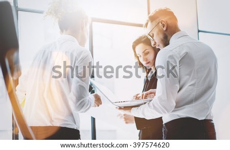 Business team work process. Photo professional crew working with new startup project. Project managers meeting. Analyze business plans laptop. Blurred background, film effect, bokeh. Horizontal - stock photo