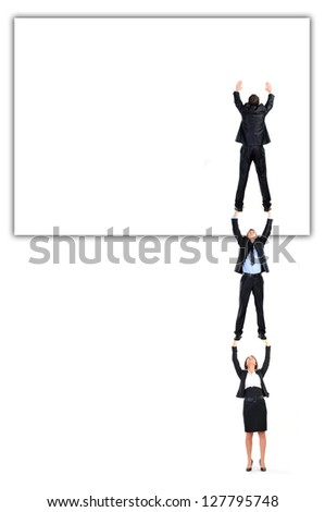 business team work. sticking ads on the board isolated on white - stock photo