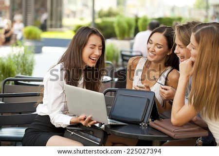 Business team working at laptop in a office outdoor - stock photo