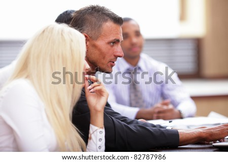 Business team working at the meeting - stock photo