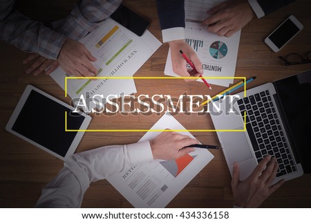 BUSINESS TEAM WORKING OFFICE  Assessment TEAMWORK BRAINSTORMING CONCEPT - stock photo