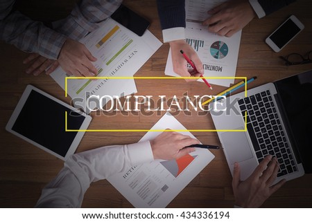 BUSINESS TEAM WORKING OFFICE  Compliance TEAMWORK BRAINSTORMING CONCEPT - stock photo