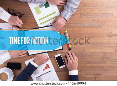 BUSINESS TEAM WORKING OFFICE TIME FOR ACTION DESK CONCEPT - stock photo