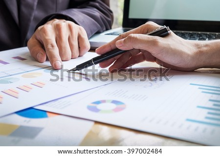 Business team working on a new business plan with modern digital computer - stock photo
