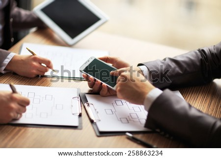 Business team working on a scheme business using the tablet and smartphone - stock photo
