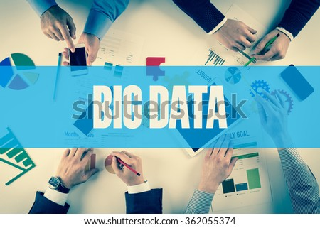 Business team working on desk with BIG DATA word - stock photo