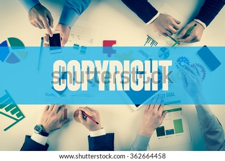 Business team working on desk with COPYRIGHT word - stock photo
