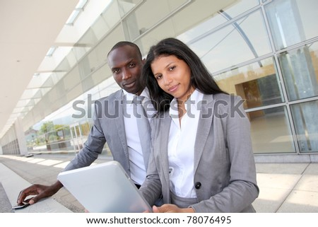 Business team working on electronic tablet