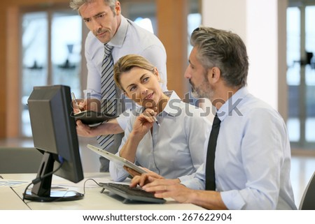Business team working on project in office