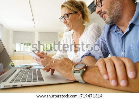 Business team working on project using laptop