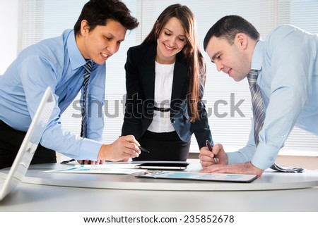 Business team working on their business project together at office - stock photo