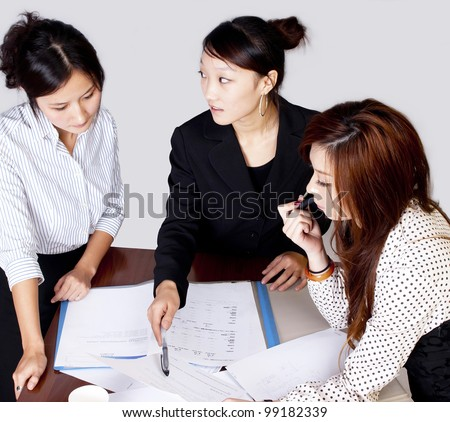 Business team working on their business project together at office - Team work