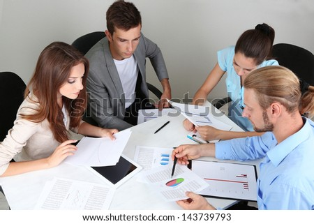 Business team working on their project together at office