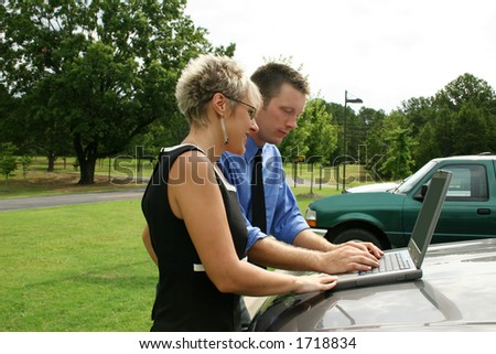 Business team working outdoors with laptop