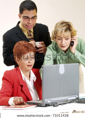 Business team working together in an office. - stock photo