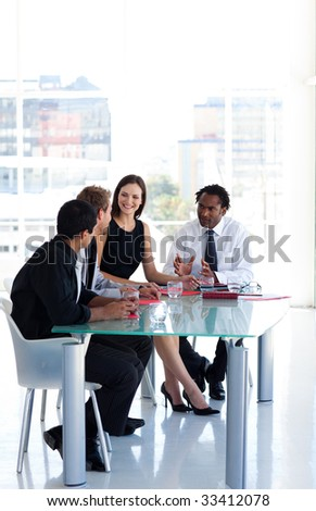Business team working together in office - stock photo