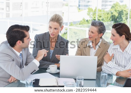 Business team working together on laptop in the office