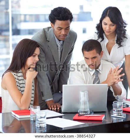 Business team working together with a project in office - stock photo