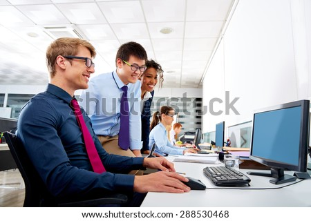Business team young people multi ethnic teamwork in office computer - stock photo