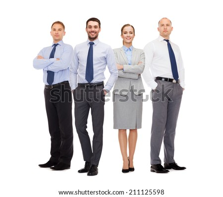 business, teamwork and people concept - group of smiling businessmen over gray concrete wall background - stock photo