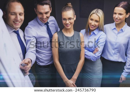 business, teamwork and people concept - smiling business team with flip board having discussion in office - stock photo