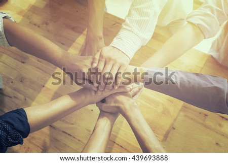 Business Teamwork concept,Business team standing hands together for united in the office.Business people joining hands together.People work Teamwork holding hands together.cooperation success  - stock photo