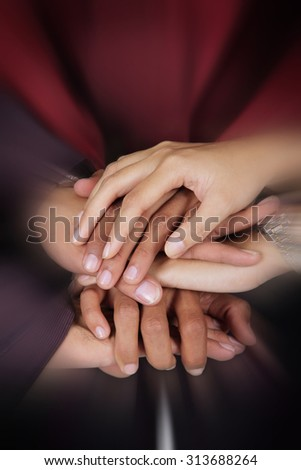 Business teamwork concept. Close up zoom on a pile of businesspeople hands - stock photo
