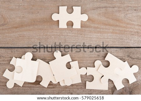 Business Teamwork Concept - Jigsaw Puzzle Pieces on wooden background