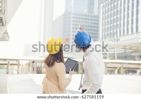 Delightful Business Teamwork Discussing On Site. Interior Design Consulting With  Building Contractor. Engineering Concept.