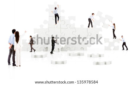 Business teamwork in action - isolated over white - stock photo