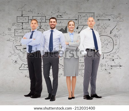 business, teamwork, planning and people concept - group of smiling businessmen over gray concrete wall with scheme drawing background - stock photo