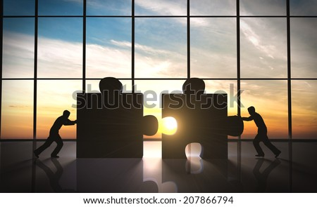Business teamwork  puzzle pieces. - stock photo