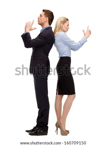 business, teamwork, secutiry, confidence concept - businesswoman and businessman with imaginary guns - stock photo