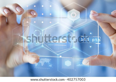 business, technology, analytics, science and people concept - close up of woman hand holding and showing transparent smartphone with virtual chart hologram on screen at office