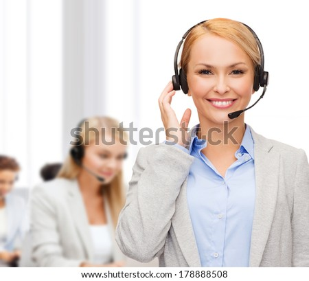 business, technology and call center concept - friendly female helpline operator with headphones at office - stock photo