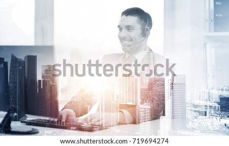 business, technology and communication concept - happy smiling male helpline operator or businessman with headset and computer at call center office over city background and double exposure effect