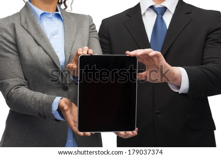 business, technology and internet concept - businessman and businesswoman with blank black tablet pc screen - stock photo