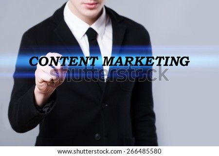 business, technology and internet concept - businessman is writing content marketing text - stock photo