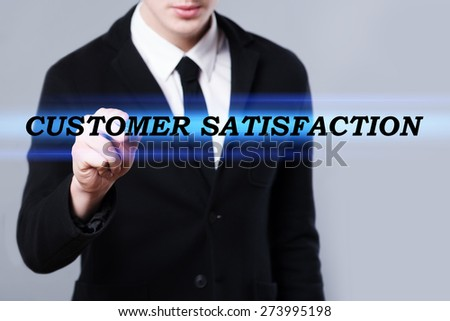 business, technology and internet concept - businessman is writing customer satisfaction text - stock photo