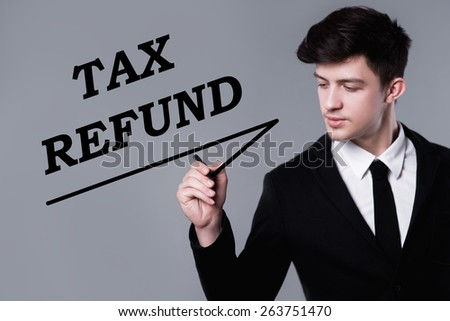 business, technology and internet concept - businessman is writing tax refund text - stock photo