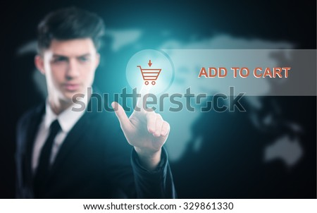 business, technology and internet  concept - businessman pressing add to cart button on virtual screens