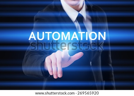business, technology and internet concept - businessman pressing automation button on virtual screens - stock photo